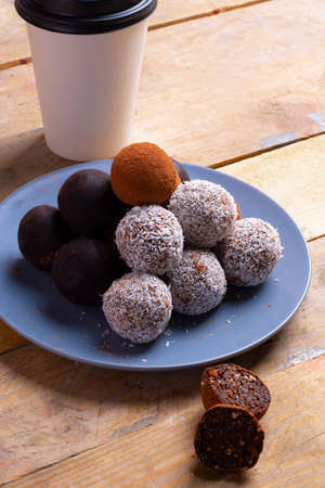 Photo pour Healthy energy organic balls with sesame seeds, coconut and a cup of coffee - image libre de droit