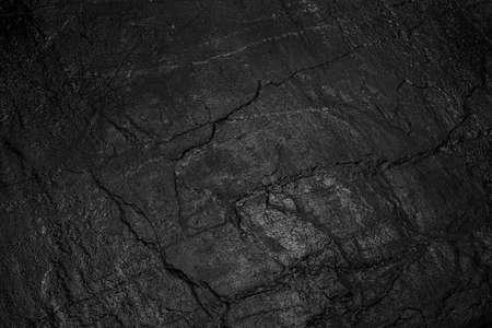 Photo pour black stone on a black background - image libre de droit