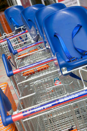 Supermarker trolleys parked in rows in close up