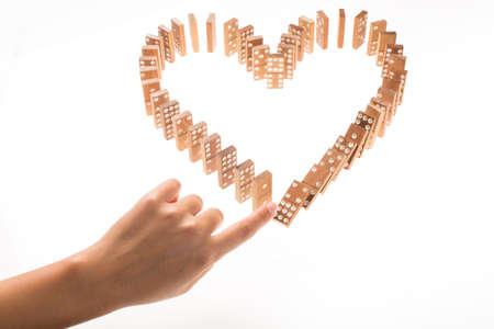 Foto de Heart Shaped Domino Rally Falling - Imagen libre de derechos