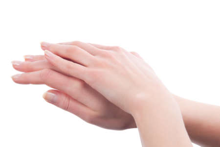 folded hands with perfect skin of young caucasian girl over white