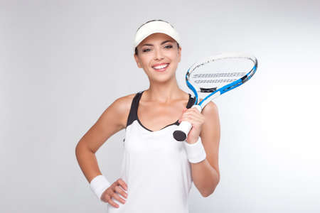 Tennis Concept: Portrait of Happy Young Caucasian Female Tennis Player Holding Racket. Horizontal Image Composition