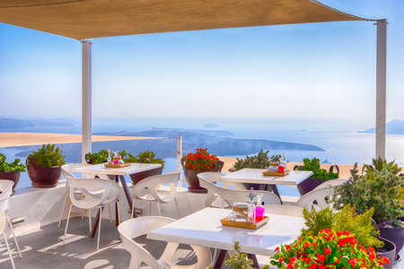 Photo for Snug Open Terace Cafe in Thira on Santorini Island in Greece. Horizontal Image - Royalty Free Image