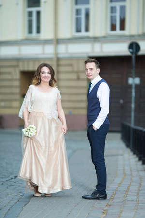 Photo for Happy Just Married Couple Having a Stroll Outdoors. Vertical Image - Royalty Free Image