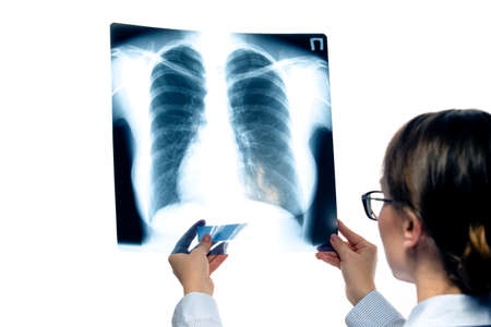 Photo pour Medicine and Healthcare. Confident Professional Radiologist Doctor Checking Patient Xray Film On Screen Against White. Horizontal Image Composition - image libre de droit