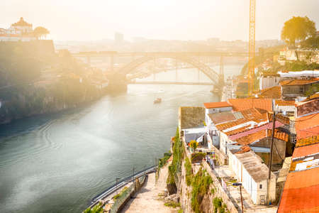 Photo pour Traditional Porto Bridges With Cityscape Rooftops At Daytime in Portugal. Horizontal Image Composition - image libre de droit