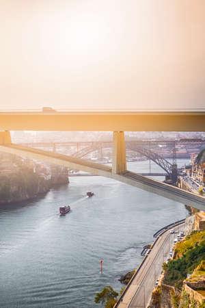Photo pour Travel Places Ideas. Line of Tourist Boats and Porto Cityscape at Daytime with Ponte Infante D Henrique in Background in Portugal. Vertical Shot - image libre de droit