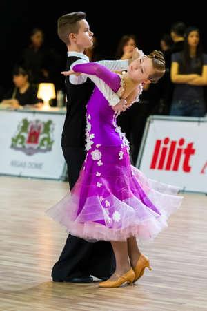 Photo pour Riga, Latvia-December 15, 2019: Professional Adult Dance Couple Performs Juvenile European Standard Program on the WDSF Baltic Grand Prix-2109 Championship in December 15, 2019 in Riga, Latvia - image libre de droit