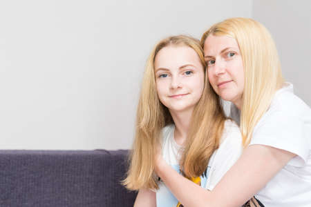Photo for Family Concepts. Young Caucasian Mother With  Her Little Daughter While Sitting Together Embraced. Horizontal image - Royalty Free Image