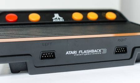 Photo for london, england, 05/05/2018 A Retro vintage atari flashback 3 arcade console re issue. A modern plug and play console with a retro 1980s style. classic vintage arcade play. - Royalty Free Image
