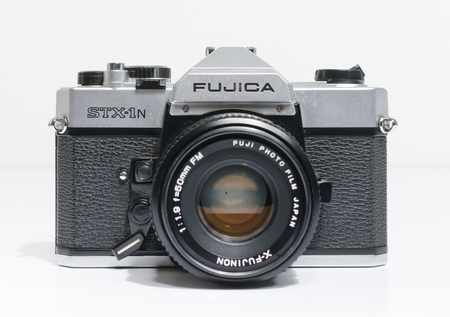 Photo for london, england, 05/05/2018 A Retro vintage FUJICA STX 1N 35mm single lens reflex film camera,and 50mm 1.8 lens. vintage hipster camera making a fashionable come back in youth culture. - Royalty Free Image