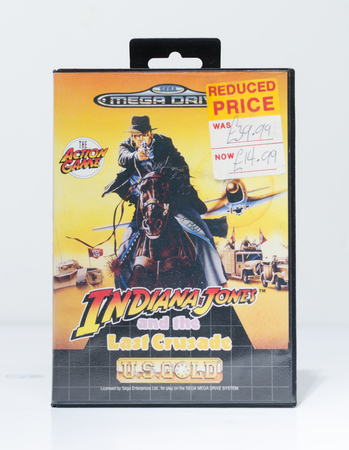 Photo for london, england, 05/05/2019 A indiana jones sega mega drive video game cartridge isolated on a white studio background. Retro and vintage console game playing from the 1990s. - Royalty Free Image