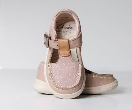Photo for london, engand, 05/05/2019 cute little vintage retro pink baby dolly shoes, isolated on a white studio background.  Tiny baby sneakers for a baby shower. Babies feet grow fast. - Royalty Free Image