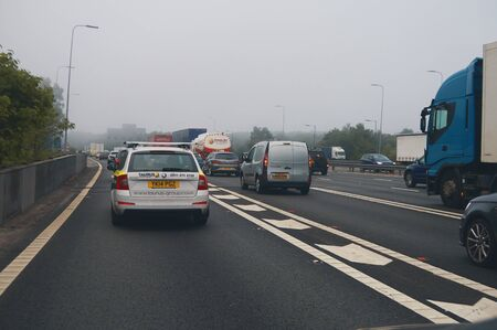 Photo for manchester, england, 05/05/2018 A motorway traffic jam in rush hour near manchester city centre on a cold dark gloomy winters morning. Manchester traffic is very very bad in the mornings on the highway. - Royalty Free Image