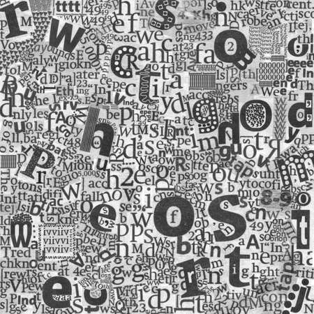 Newspaper's letters on the real newspaper's texture background.