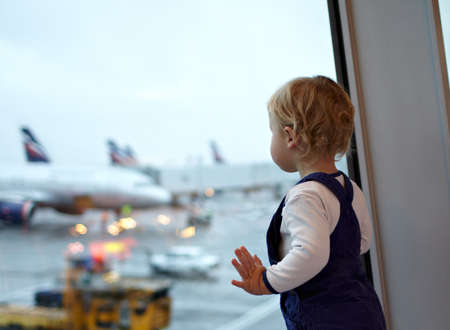 Kid near the window in the airport