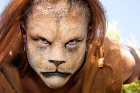 Close -up and meancing face of a Lion man looking into the camera   Fantastic special FX make up of Rayce Bird