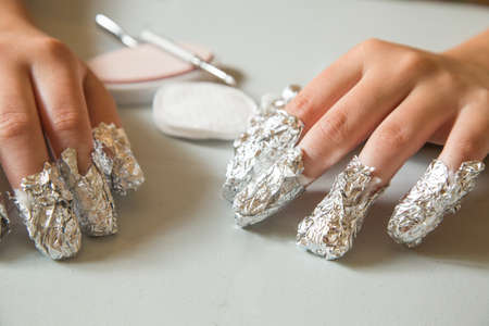 waiting for the shellac to soften.  The nails are applied with acetone and wrapped in aluminum foil to remove shellac nails saefly at home