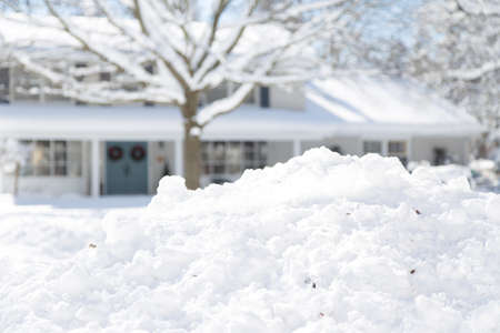 shallow depth of field focused on snow with the house in background