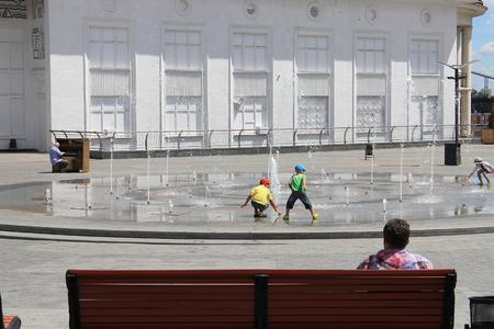 children play near the fountain
