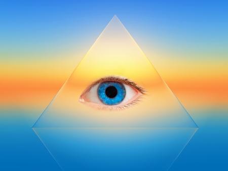 a blue eye in a transparent pyramid