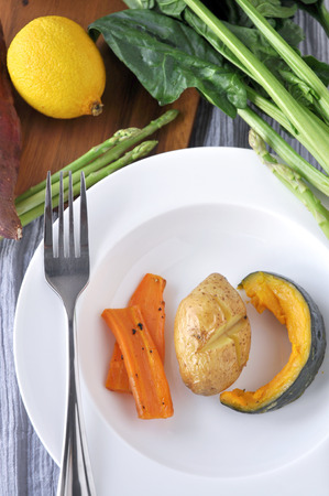 Healthy food potato pumpkin and carrot on white dish