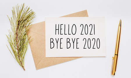 Photo for hello 2021 bye bye 2020 note with envelope, spruce branch and gold pen on white background. merry christmas and New Year concept - Royalty Free Image