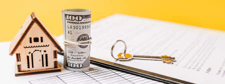 Photo pour House miniature model and money on documents. Investment, real estate, home, housing - image libre de droit