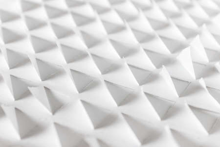 Photo pour White paper 3d pattern with repeating triangle shapes made of white paper. - image libre de droit