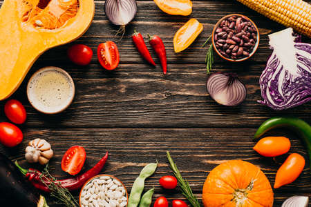 Photo for Food frame. Fresh Vegetables on a Wooden Background. Copy Place - Royalty Free Image