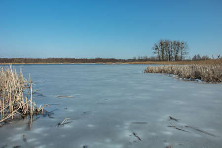 Photo for Stankow frozen lake in eastern Poland - view in winter day - Royalty Free Image