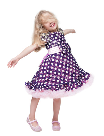 Beautiful little girl spinning around isolated over white background
