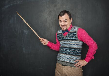 Photo pour Funny giggle teacher man with pointer on blackboard background - image libre de droit