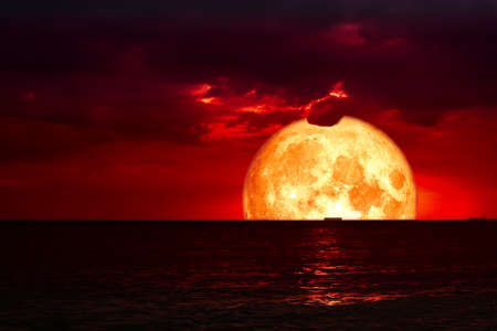 half blood moon on night sea and back silhouette red cloud.