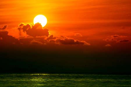 Foto de multicolor heap red sunset cloud and sun on sky background - Imagen libre de derechos
