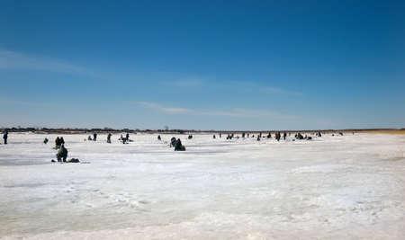 Foto de fishermen on the ice lake winter fishing hobby leisure winter sports group crowd - Imagen libre de derechos
