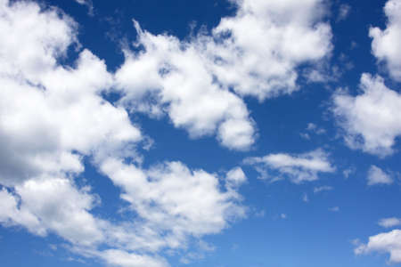 White fluffy Cumulus clouds on a blue sky background
