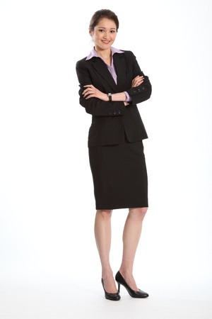 Career woman in black suit arms folded