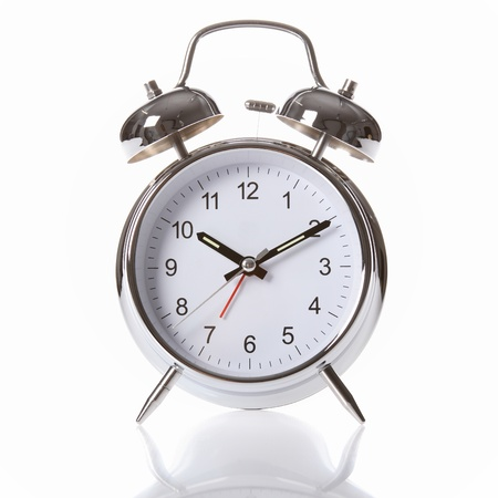 Traditional silver and chrome alarm clock, with big clear numerals and two alarm bells on top.