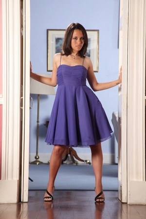Fashion model strikes sexy pose in doorway