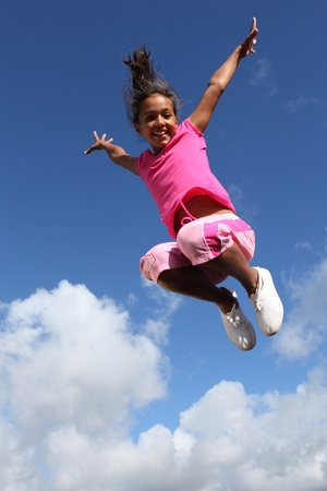 Sky is the limit for joyful young school girl