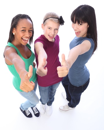 Excited thumbs up in success by three multi cultural teenage school student friends made up of mixed race african american, oriental Japanese and caucasian all happy holding hands out to camera.の写真素材