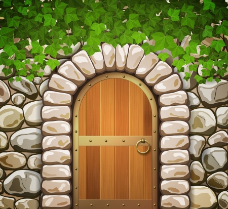 Stone wall with arched medieval wooden door and leaves
