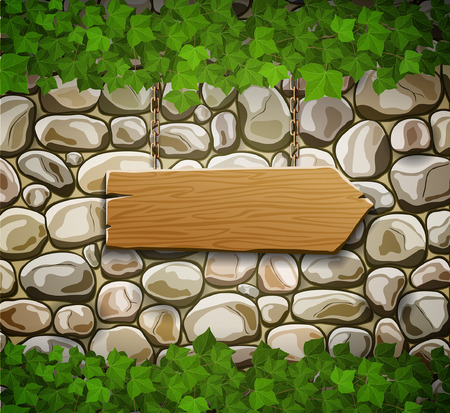Stone wall with wooden arrow and leaves