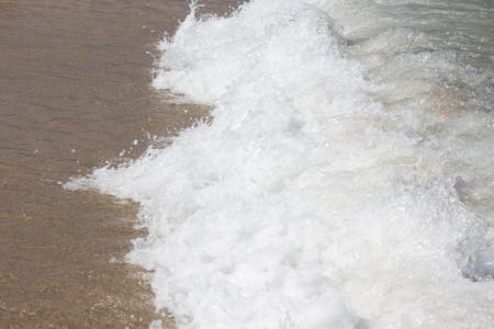 foaming ocean waves at the beach