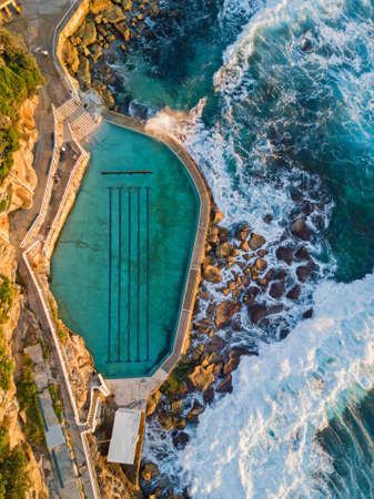 Aerial view of Bronte rock pool with incoming waves