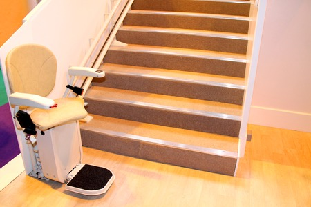An Electric Powered Assistance Stair Lift with Seat.