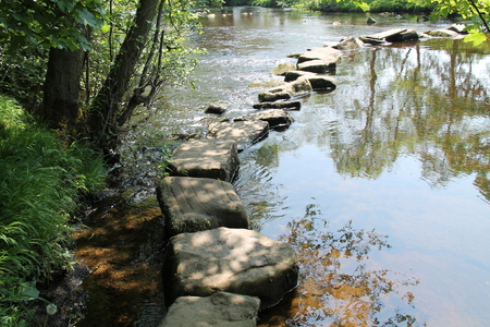 Rocky Stepping Stones Across a Beautiful Rural River.