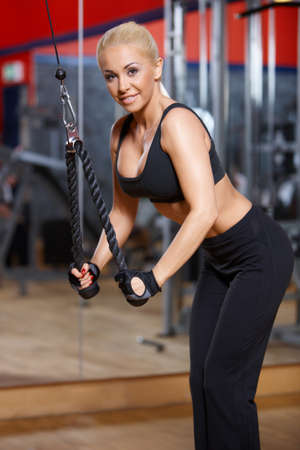 Beautiful woman exercising at the gym