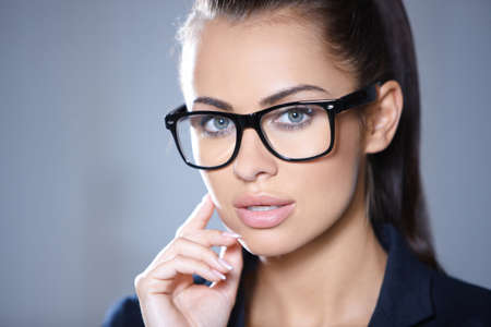 Portrait of beautiful business woman wearing glassesの写真素材